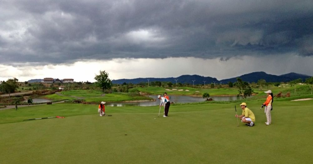 Putting in Hole 6 with Dark Clouds Hanging in the Background