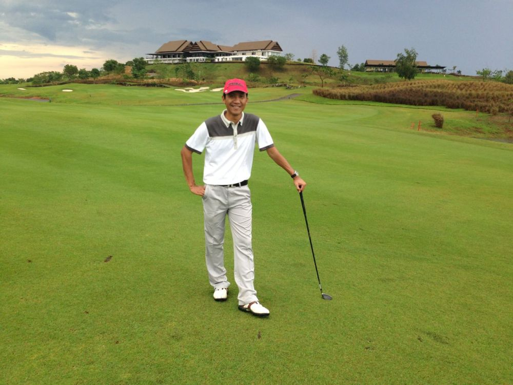 I was Happily Posed in Hole 9 of Padi Valley, After the Rain, with Club House in Background.